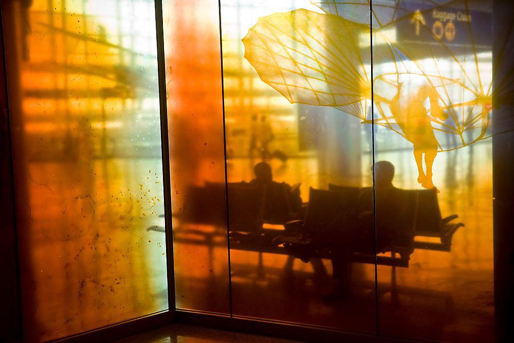 Travelers sit on benches at SeaTac Airport, Seattle, Washington.
