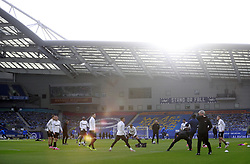 West Ham United players warming up prior to kick-off inside an empty stadium during the Premier League match at the American Express Community Stadium, Brighton. Picture date: Saturday May 15, 2021.