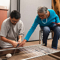 Diné weaver Lois A. Becenti helps John Lateyice of Zuni with his warp at a Navajo Rug Weaving Class Friday, Jan. 17 at the Octavia Fellin Public Library in Gallup. Becenti will host free rug weaving classes Friday Feb. 21 and Friday March 20 from 10 am to 3 pm at the Octavia Fellin Public Library in Gallup.