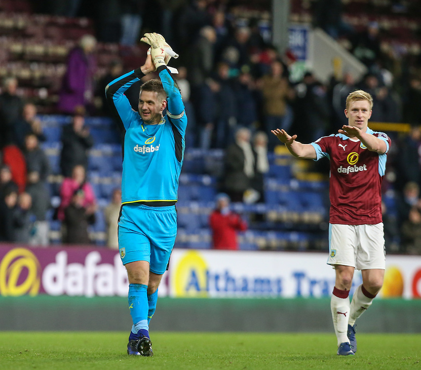 Burnley's Ben Mee salutes the performance of Tom Heaton as the pair celebrate with fans<br /> <br /> Photographer Alex Dodd/CameraSport<br /> <br /> The Premier League - Burnley v Southampton - Saturday 14th January 2017 - Turf Moor - Burnley<br /> <br /> World Copyright © 2017 CameraSport. All rights reserved. 43 Linden Ave. Countesthorpe. Leicester. England. LE8 5PG - Tel: +44 (0) 116 277 4147 - admin@camerasport.com - www.camerasport.com