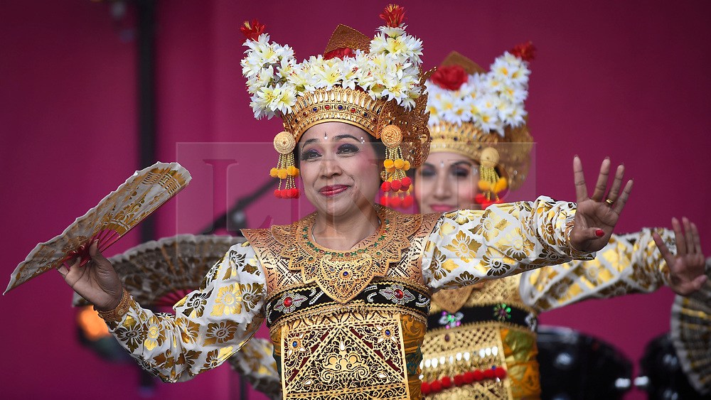 © Licensed to London News Pictures. 08/06/2019. LONDON, UK.  Members of Lila Bhawa, the UK's leading Indonesian Dance Group, perform as people celebrate the EID Festival in Trafalgar Square, an event hosted by The Mayor of London.  The Mayor's festival takes place in the square one week after the end of Ramadan and includes a variety of stage performances and cultural activities.  Photo credit: Stephen Chung/LNP