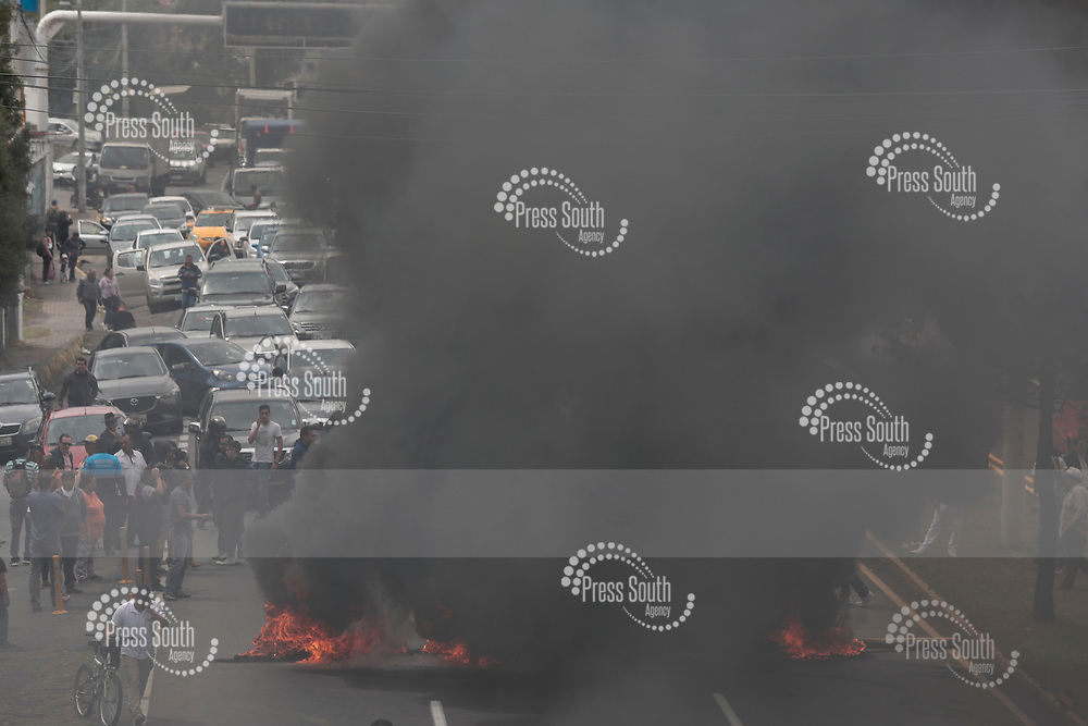 QUITO, ECUADOR - OCTOBER 03: Protesters block the Rumiñahui General Highway one of the main roads that connects the valley with Quito during a protest against President of Ecuador Lenin Moreno after he announced the withdrawal of fuel subsidies on October 3, 2019 in Quito, Ecuador. Transport workers are on strike and classes have been suspended. (Photo by Franklin Jacome/Agencia Press South/Getty Images)