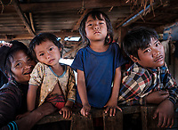 KYAING TONG, MYANMAR - CIRCA DECEMBER 2017: Portrait of family at the Pan Ian Village, Enn tribe also known as Eng or Black Teeth around Kyaing Tong