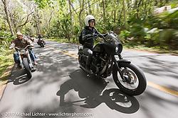 Iron Lilly Kristen Lassen (R) on a Harley-Davidson Sportster rides with Eric Stein on his 1964 custom Harley-Davidson Panhead through Tomoka State Park during Daytona Beach Bike Week. FL. USA. Tuesday, March 14, 2017. Photography ©2017 Michael Lichter.
