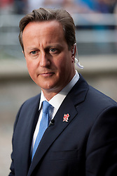 © Licensed to London News Pictures. 10/09/2012. LONDON, UK. British Prime Minister David Cameron is seen outside a reception for Olympic and Paralymic athletes at the Queen Elizabeth II Conference Centre in London today (10/09/12). Photo credit: Matt Cetti-Roberts/LNP