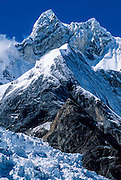 """Glaciers flow from Mount Jirishanca, or the """"Icy Beak of the Hummingbird"""" (west face, 6126 m or 20,098 feet elevation), third highest in the Cordillera Huayhuash, tenth highest in Peru. Andes Mountains, South America."""