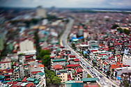 Tilt shift cityscape of Hanoi as viewed from the Summit Lounge of the Sofitel Plaza, Vietnam.