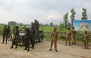 Indian Army and paramilitary soldiers at the site of an explosion.