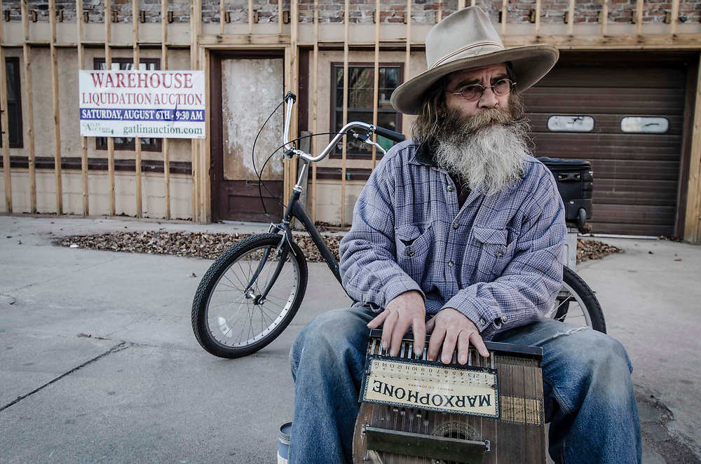 A street musician braves the cold on a winters day in Pueblo, Colorado. USA
