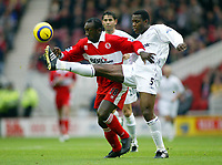 7/11/2004 - FA Barclayship Premiership - Middlesbrough v Bolton Wanderers - The Riverside Stadium<br />Bolton Wanderers' Bruno N'Gotty gets a long leg around middlesbrough's Jimmy Floyd Hasselbaink<br />Photo:Jed Leicester/Back Page Images