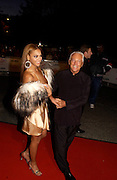 giorgio Armani and Beyonce, Fashion Rocks in aid of the Princes trust, royal albert Hall, 15  october 2003.   © Copyright Photograph by Dafydd Jones 66 Stockwell Park Rd. London SW9 0DA Tel 020 7733 0108 www.dafjones.com