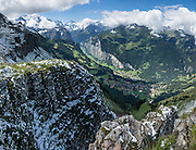 Snow in August on Männlichen Royal Walk, above Lauterbrunnen Valley, Switzerland, the Alps, Europe. This image was stitched from multiple overlapping photos.