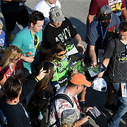 Danica Patrick, driver of the (7) GoDaddy Chevrolet is mobbed by fans in the garage area after practice for the 60th Annual NASCAR Daytona 500 auto race at Daytona International Speedway on Friday, February 16, 2018 in Daytona Beach, Florida.  (Alex Menendez via AP)