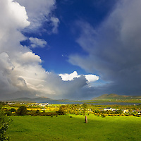Stormy Sunrise Sky over  Cahersiveen with Megalith and Lion Figure in the sky, County Kerry, Ireland / ch244