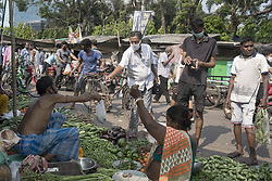 Indian people buy vegetables at Muchi bazzar in Kolkata. India is going through a 21 days lock down for Corona virus pandemic. As the government gave relaxation to lockdown in the morning to shop for daily needs hence neither the social distancing is maitained nor people are using protective masks and gloves, now the authorities are concerned about the spread of the disease. Kolkata, West Bengal, India on April 2, 2020. Photo by Arindam Mukherjee/ABACAPRESS.COM.