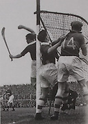 Cork goalkeeper Dave Creedon saves, while Corner back Tony O'Shaughnessy provides protection in the 1952 Munster final against Tipperary.