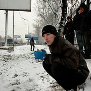 Unemployed people stand by a snow covered highway waiting for work in Moscow's outskirt at the height of the financial crisis. ..Picture by Justin Jin.