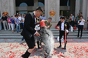 ZHENGZHOU, CHINA - JUNE 13: (CHINA OUT)<br /> <br /> Crazy Wedding Ceremony In Zhengzhou, China<br /> <br /> A bridegroom, armed with gas mask and women's underwear, is attacked by his relatives with oil, sauce, flour and eggs during a wedding ceremony in front of a hotel on June 13, 2013 in Zhengzhou, Henan Province of China. <br /> ©Exclusivepix