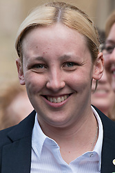 © London News Pictures. 11/05/2015. MP for Paisley and Renfrewshire South, Mhairi Black, one of 56 SNP Members of Parliament, outside the St Stephens Entrance to the Houses of Parliament as all 56 SNP MPs arrive at Westminster following their election sucess. Photo credit: Ben Cawthra/LNP