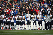 The New England Patriots line up with hands across their hearts during the playing of the National Anthem before the 2017 NFL week 13 regular season football game against the Buffalo Bills, Sunday, Dec. 3, 2017 in Orchard Park, N.Y. The Patriots won the game 23-3. (©Paul Anthony Spinelli)