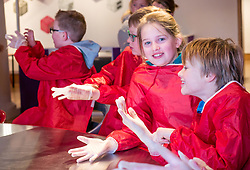 City Arts Centre, Edinburgh, Scotland, United Kingdom, 9 April 2019City Arts Centre, Edinburgh, Scotland, United Kingdom, 9 April 2019. Edinburgh Science Festival:  Kastinka, age 11 years and other children don gloves to have fun learning about blood with a sheep heart at the Blood Bar drop in event with Science Communicator Hannah at the Science Festival. <br /> <br /> Sally Anderson | EdinburghElitemedia.co.uk