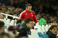 Wayne Rooney of Manchester United  getting ready to be subbed on. The Emirates FA cup, 6th round replay match, West Ham Utd v Manchester Utd at the Boleyn Ground, Upton Park  in London on Wednesday 13th April 2016.<br /> pic by John Patrick Fletcher, Andrew Orchard sports photography.