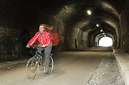Cyclist riding through the Headstone tunnel on the newly re-opened Monsal Tunnels section of the Monsal Trail. Long exposure with additional flash.