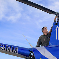 Isaac Wilson inspects the rotor of his helicopter as he runs down his pre-flight checklist at Double Eagle II Airport in Albuquerque Friday.