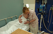 Eileen Brazil, age 18, is seen with bedside educator Brigid Higgins at Memorial Sloan-Kettering Cancer Center in Manhattan, NY. She receives chemo. 6/14/2005 Photo by Jennifer S. Altman