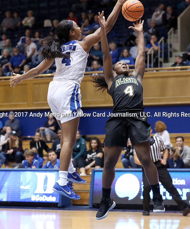 DURHAM, NC - NOVEMBER 05: Duke's Lexie Brown (left) blocks a shot by Alaska Anchorage's Kian McNair (right). The Duke University Blue Devils hosted the University of Alaska Anchorage Seawolves on November 5, 2017 at Cameron Indoor Stadium in Durham, NC in a Division I women's college basketball preseason exhibition game. Duke won the game 87-56.
