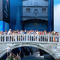 VENICE, ITALY - AUGUST 11:  Tourists stand ona bridge facing the famous Bridge of Sighs behind St Mark's Square on August 11, 2011 in Venice, Italy. Italian heritage group Italia Nostra warned  that Venice is facing an irreversible environmental catastrophe unless visitor numbers are capped. The acceptable maximum number of tourists for Venice is 33,000. In 2011 the average number of visitors to the city daily is 60,000 that is too high for such a fragile city and is causing the gradual destruction of the lagoon ecosystem.