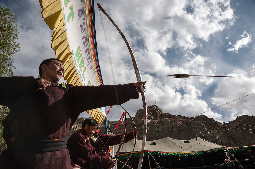 A Ladakhi man lets an arrow fly during the archery competition at the Ladakh Festival, held each September in Leh, Ladakh, India.