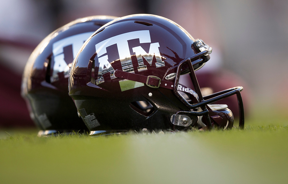 Texas A&M reflective helmets sit on the field before the start of a NCAA college football against Mississippi State on Saturday, Oct. 28, 2017, in College Station, Texas. (AP Photo/Sam Craft)