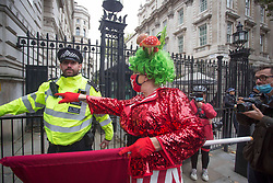 Licensed to London News Pictures. 30/09/2020. London, UK. Pantomime dames lead workers from the theatre and live events industry from West End to Parliament Square in Central London. Protestors want to highlight the chalanges of the theatre industry high on the government agenda. Photo credit: Marcin Nowak/LNP