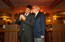 Warren Buffett poses with business students from universities around the country after at lunch at Piccolo Pete's Restaurant in Omaha, Neb., Nov. 11, 2011. Here, Buffett poses with Sparky Garcia of Gonzaga University.
