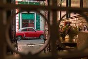 City street with car from behind bars, Havana, Cuba