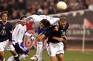 10 February 2006: Japan's Seiichiro Maki (left) goes over US defender Jimmy Conrad (right) for a header. The United States Men's National Team defeated Japan 3-2 at SBC Park in San Francisco, California in an International Friendly soccer match.
