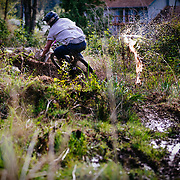Owen Dudley burns a high speed turn through the mud on private land near Bellingham Washington.
