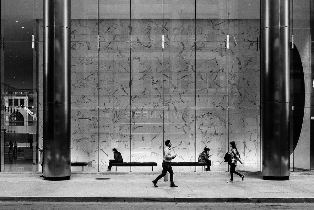 People walking the streets of Toronto's financial district. Street photography on Toronto's Adelaide Street.