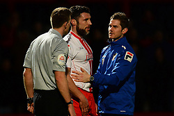 Stevenage's Jon Ashton gets treated for a head injury - Photo mandatory by-line: Mitchell Gunn/JMP - Tel: Mobile: 07966 386802 22/02/2014 - SPORT - FOOTBALL - Broadhall Way - Stevenage - Stevenage v Crewe Alexandra - League One