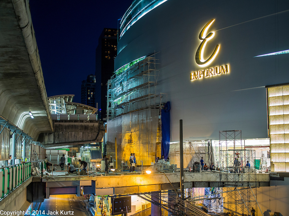 19 NOVEMBER 2014 - BANGKOK, THAILAND: Workers on the job at the expansion of the Emporium, a high end mall in Bangkok. Despite a slowdown in the Thai economy, many construction projects are still underway. Between July and September the economy expanded 0.6 percent compared to the previous year, the National Economic and Social Development Board (NESDB) reported. Thailand's economy achieved a weak 0.2 per cent growth across the first nine months of the year. The NESDB said the Thai economy is expected to grow by 1 percent in 2014. Authorities say the sluggish growth is because tourists have not returned to Thailand in the wake of the coup in May, 2014, and that reduced demand for computer components, specifically hard drives, was also hurting the economy. Thailand is the leading manufacturer of computer hard drives in the world. The Thai government has announced a stimulus package worth $11 billion (US) to provide cash handouts to farmers and promised to speed up budget spending to boost consumption.   PHOTO BY JACK KURTZ