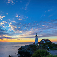 Portland Head Light lighthouse at Fort Williams Park is an iconic New England landmark located on Cape Elizabeth in Maine. The lighthouse towers over the swirling Atlantic Ocean and seacoast, marking the entrance to Casco Bay and Portland. Upon arrival the gates to the park were already open leaving me enough time to scout for an appropriate composition that allows to incorporate the anticipated magical morning show in the sky and some of the dramatic seascape of coastal Maine.<br /> <br /> This picturesque New England lighthouse photography image is available as museum quality photography prints, canvas prints, acrylic prints, wood prints or metal prints. Fine art prints may be framed and matted to the individual liking and decorating needs:<br /> <br /> https://juergen-roth.pixels.com/featured/portland-head-light-lighthouse-juergen-roth.html<br /> <br /> Good light and happy photo making!<br /> <br /> My best,<br /> <br /> Juergen<br /> Prints: http://www.rothgalleries.com<br /> Photo Blog: http://whereintheworldisjuergen.blogspot.com<br /> Instagram: https://www.instagram.com/rothgalleries<br /> Twitter: https://twitter.com/naturefineart<br /> Facebook: https://www.facebook.com/naturefineart