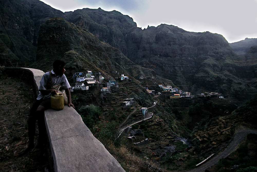 A boy looks at the landscape of Fontainhas Valley. Fontainhas village in the north coast of Santo Antao is an extraordinary scenery. To go there it takes one hour, because distances are time measured in Santo Antao.