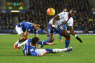 Yannick Bolasie of Crystal Palace (r) is tackled by Ramiro Funes Mori of Everton. Barclays Premier league match, Everton v Crystal Palace at Goodison Park in Liverpool, Merseyside on Monday 7th December 2015.<br /> pic by Chris Stading, Andrew Orchard sports photography.
