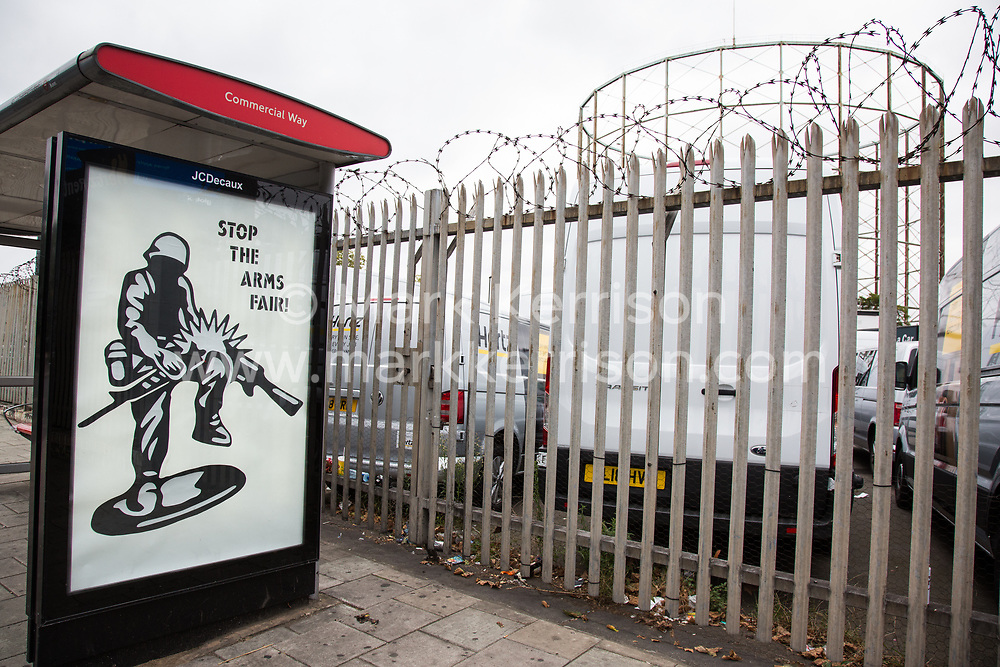 London, UK. 11 September, 2019. Stop The Arms Fair artwork by Protest Stencil is displayed at a bus shelter in South London in protest against the DSEI arms fair at ExCel London. The artwork references a toy soldier graphic from Peace Action Wellington, who campaigned to shut down an arms fair in New Zealand.