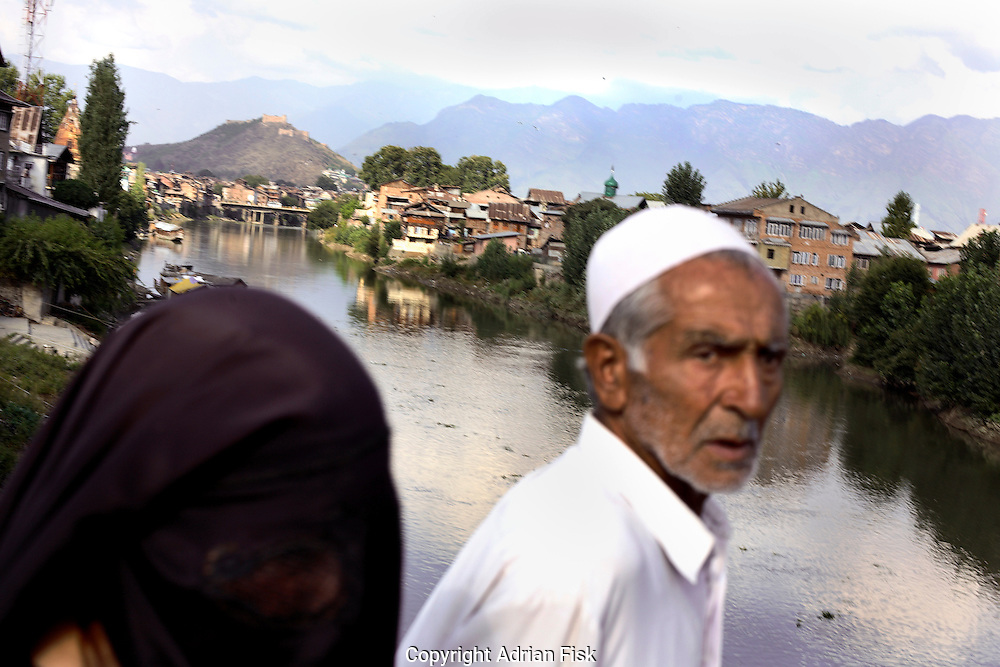 On the 22nd August 2008 an estimated 350,000 Kashmiri's marched to the Eidgha communal ground in Srinagar demanding Independence from India. Local Kashmiri's said they had never witnessed anything like it in their lifetime. .Srinagar lies in the background as an old man and his wife return home after the march....