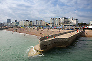 Brighton seafront captured from Brighton Pier on the 19th July 2018 in Brighton in the United Kingdom. The Brighton Palace Pier, commonly known as Brighton Pier or the Palace Pier is a Grade II* listed pleasure pier in Brighton, England, located in the city centre opposite the Old Steine.
