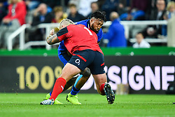 Jimmy Tuivaiti of Italy is tackled by Joe Marler of England<br /> <br /> Photographer Craig Thomas/Replay Images<br /> <br /> Quilter International - England v Italy - Friday 6th September 2019 - St James' Park - Newcastle<br /> <br /> World Copyright © Replay Images . All rights reserved. info@replayimages.co.uk - http://replayimages.co.uk
