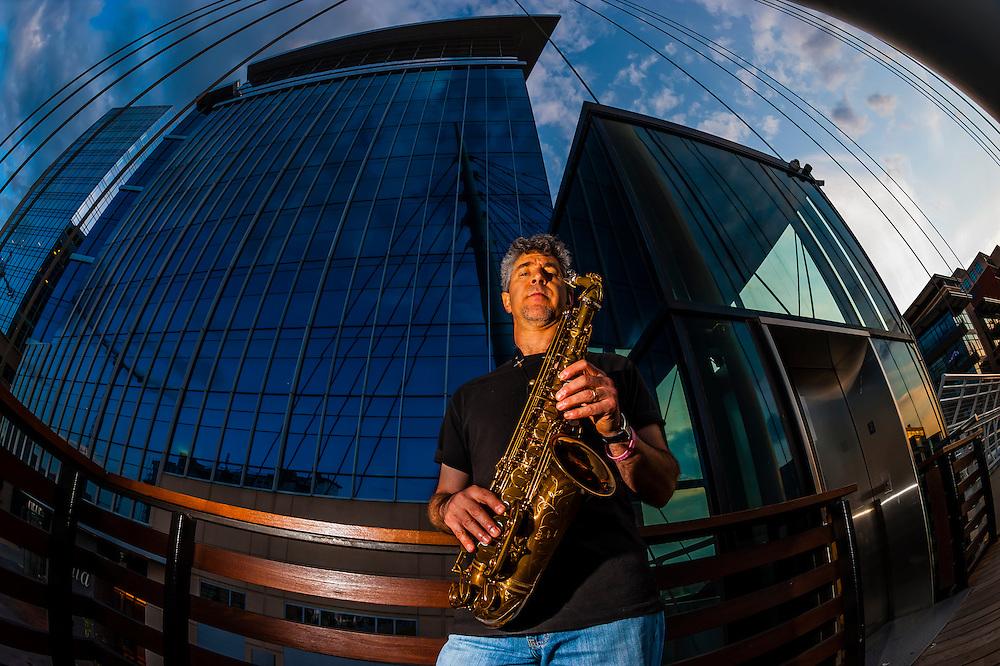 Saxophonist Nelson Rangell on the Millennium Bridge, Downtown Denver, Colorado USA.