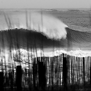 A wave breaks on Wrightsville Beach, NC.